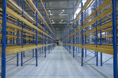 empty warehouse: empty new warehouse prepared to start business - with racks Editorial