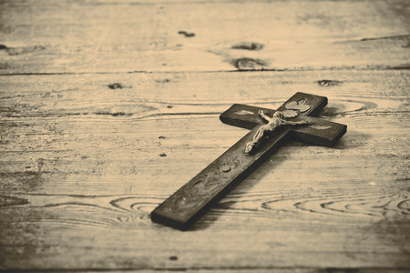 faith: Beautiful old cross with jesus on the old wooden floor