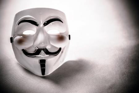 vendetta: white anonymous mask on white  Editorial