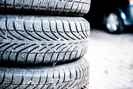 auto service: car tires prepared to replace in a garage Stock Photo