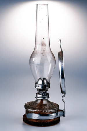 old kerosene lamp with mirror isolated on white background - retro photo