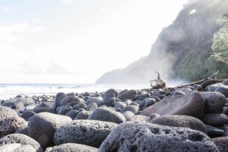 beautiful black stone beach - waipio valley, hawaii island photo