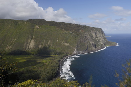 beautiful black stone beach - waipio valley, hawaii island photo