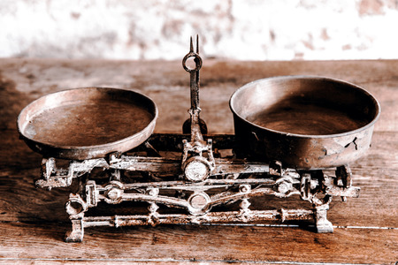 antique: Old Antique weight measuring and kitchen goods weighing on the wooden table Stock Photo