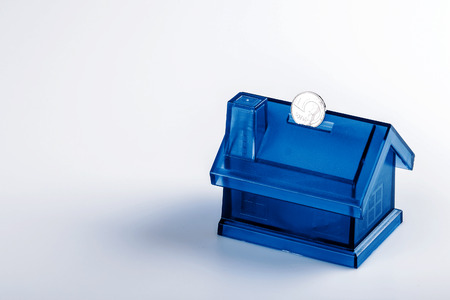 coin box: Blue House Money Box on White Background with coin Stock Photo