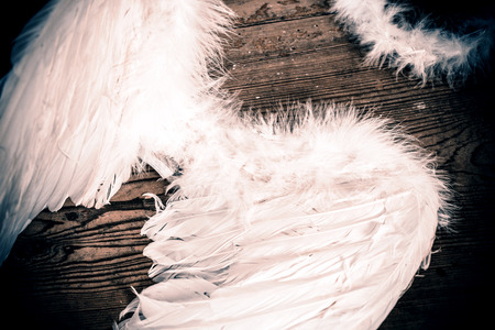 angel wings on the wooden floor - retro Stock Photo - 37917021