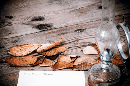 Old fashioned letter with a lamp and leafs photo