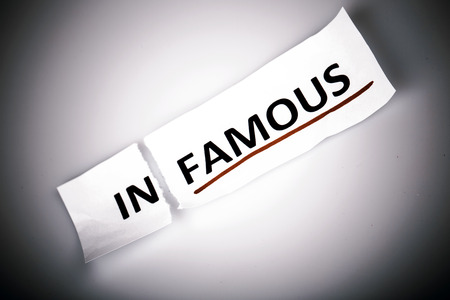 changed: The word infamous changed to famous on torn paper and white background