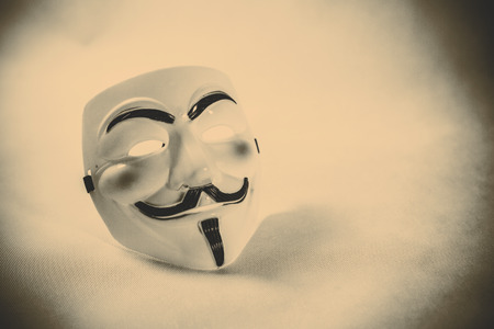 guy fawkes mask: white anonymous mask on white background Stock Photo