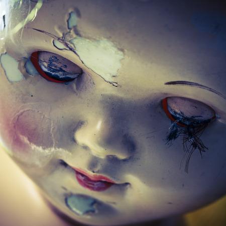 doll: head of beatiful scary doll like from horror movie - evil face, grunge, macro Stock Photo