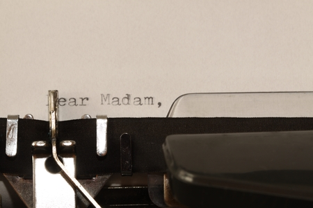 madam: Letter with a title Dear Madam typed on old typewriter