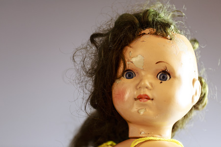 head of beatiful scary doll like from horror movie - evil face, grunge, macro Stockfoto