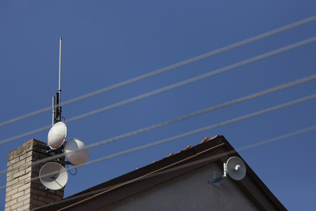 access point: wifi dish and antenna on the roof of house - access point to internet