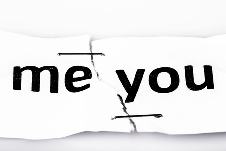 stapled: me you words written on torn and stapled paper on white