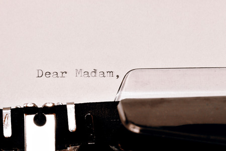 dear: Letter with a title Dear Madam typed on old typewriter