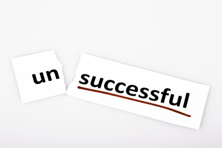changed: The word unsuccessful changed to successful on torn paper and white background Stock Photo