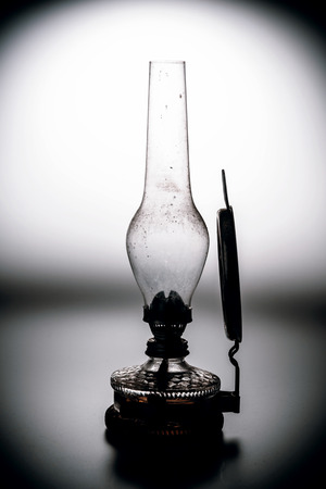kerosene: old kerosene lamp with mirror isolated on white background - retro