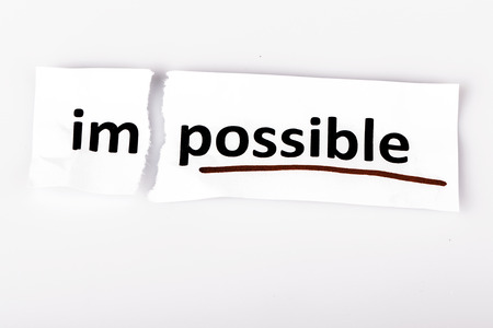 changed: The word impossible changed to possible on torn paper and white background