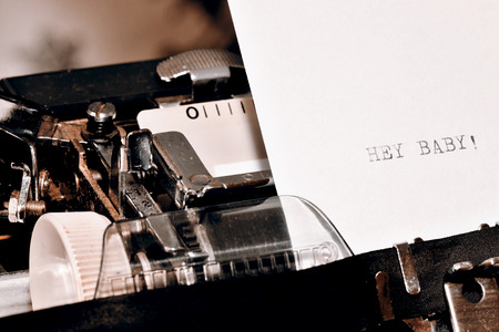 written communication: Letter with a title Hey Baby typed on old typewriter Stock Photo