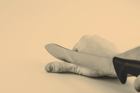 suicidal: Close up of a suicidal man hand on isolated white background