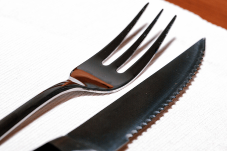prongs: Steak cuttlery - fork and knife on the table