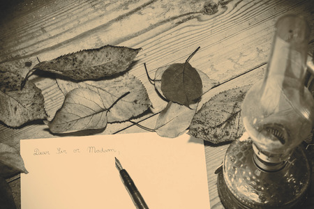 addressing: Old fashioned letter with a pen and leafs Stock Photo