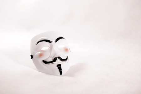 guy fawkes mask: white anonymous mask on white background Editorial