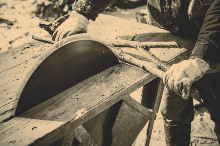saw blade: Man working with old handmade circular saw blade Stock Photo