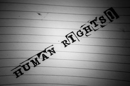 repress: human rights text on paper in retro style