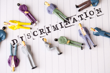 sex discrimination: discrimination text on white paper with disabled people around