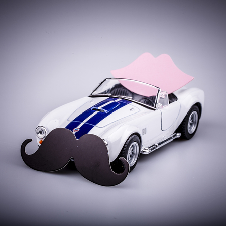 speedster: bautiful blue and white car, roadster with pink kiss and black mustache, valentine car