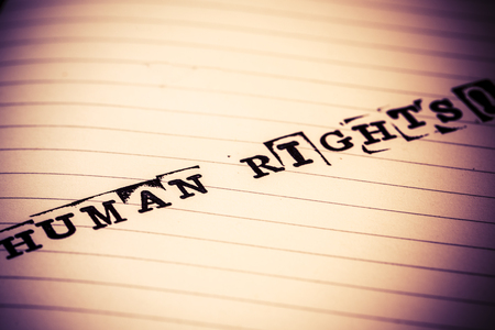 human rights text on paper in retro style