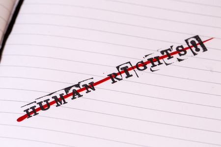 repress: no human rights, strikethrough text on paper in retro style