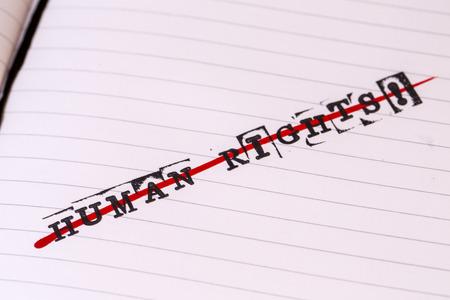 strikethrough: no human rights, strikethrough text on paper in retro style