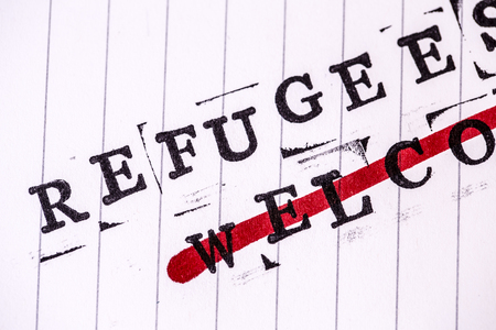 amnesty: refugees welcome strikethroughtext on white line paper Stock Photo