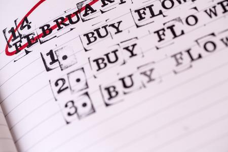14 february: calendar planner - 14 february, valentine day, buy flowers text, task Stock Photo