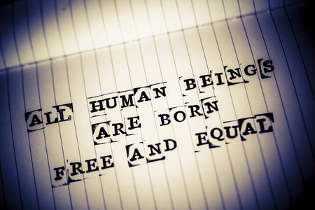 political prisoner: all human beings are born free and equal text on paper in retro style