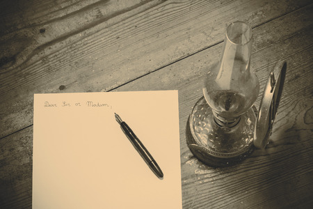 addressing: Old fashioned letter with a pen and lamp
