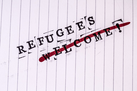 strikethrough: refugees welcome strikethrough text on white line paper