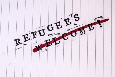 strikethrough: refugees welcome strikethrough text on white line paper