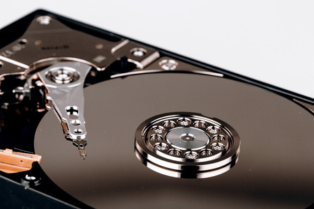 databank: Inside Hard disk drive HDD isolated on white background