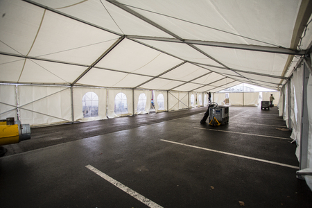 inside big white party tent - preparation for party or wedding