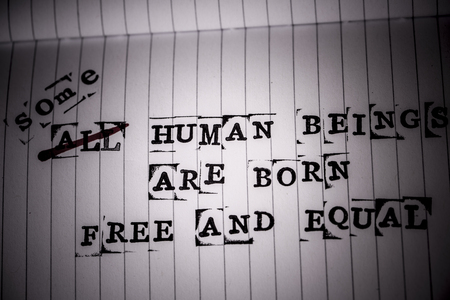 all human beings are born free and equal text on paper in retro style