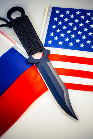 cold war: United States of America and Russia flags with knife - cold war conflict Stock Photo