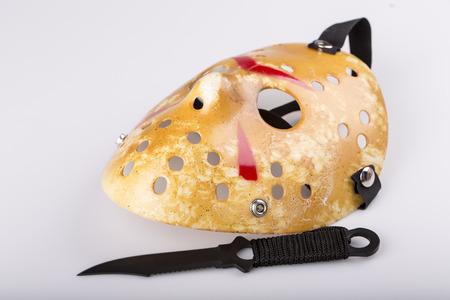 male killer: murder concept - assassin mask and knife on white