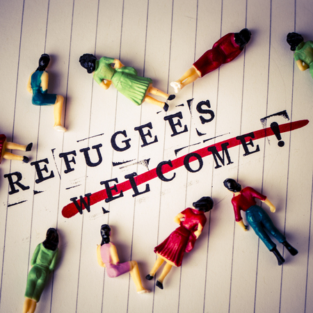 face off: refugees welcome strikethrough text on white line paper with face off woman figures around