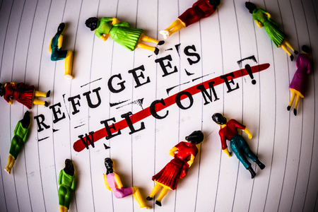 strikethrough: refugees welcome strikethrough text on white line paper with face off woman figures around