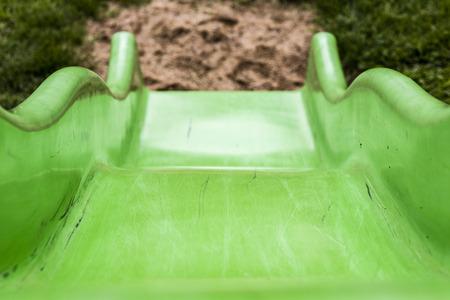 entertaiment: Green child slide on playground, entertaiment tool
