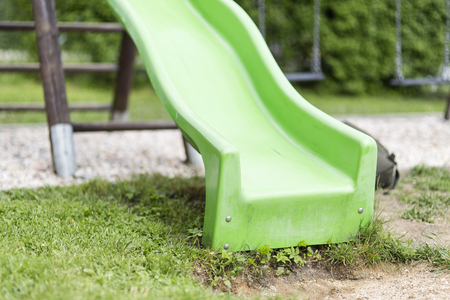 playtime: Green child slide on playground, entertaiment tool
