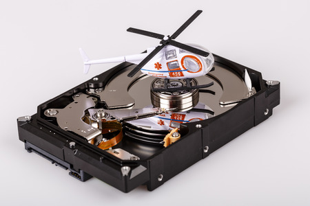 hard disk: ambulance helicopter or chopper on harddrive or hdd - data backup, safe and rescue concept